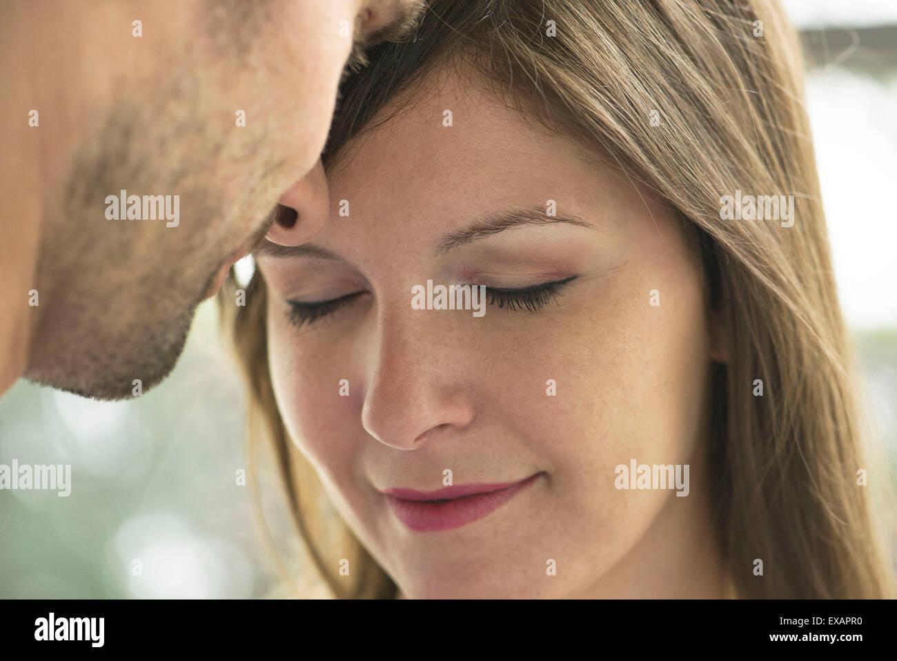 Couple nuzzling, close-up - Stock Image