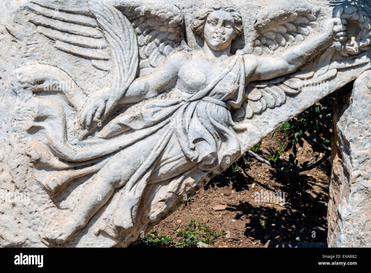 Stone carving of the goddess Nike at Hercules Gate, Ephesus, Izmir, Turkey - Stock Image