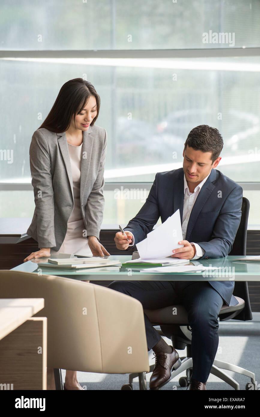 Secretary working with executive - Stock Image