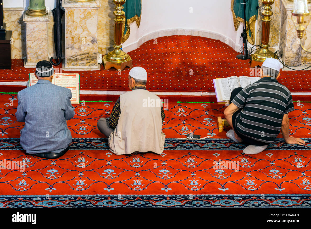 Worshipers praying inside Hisar Camii or Fortress Mosque, Izmir, Turkey - Stock Image
