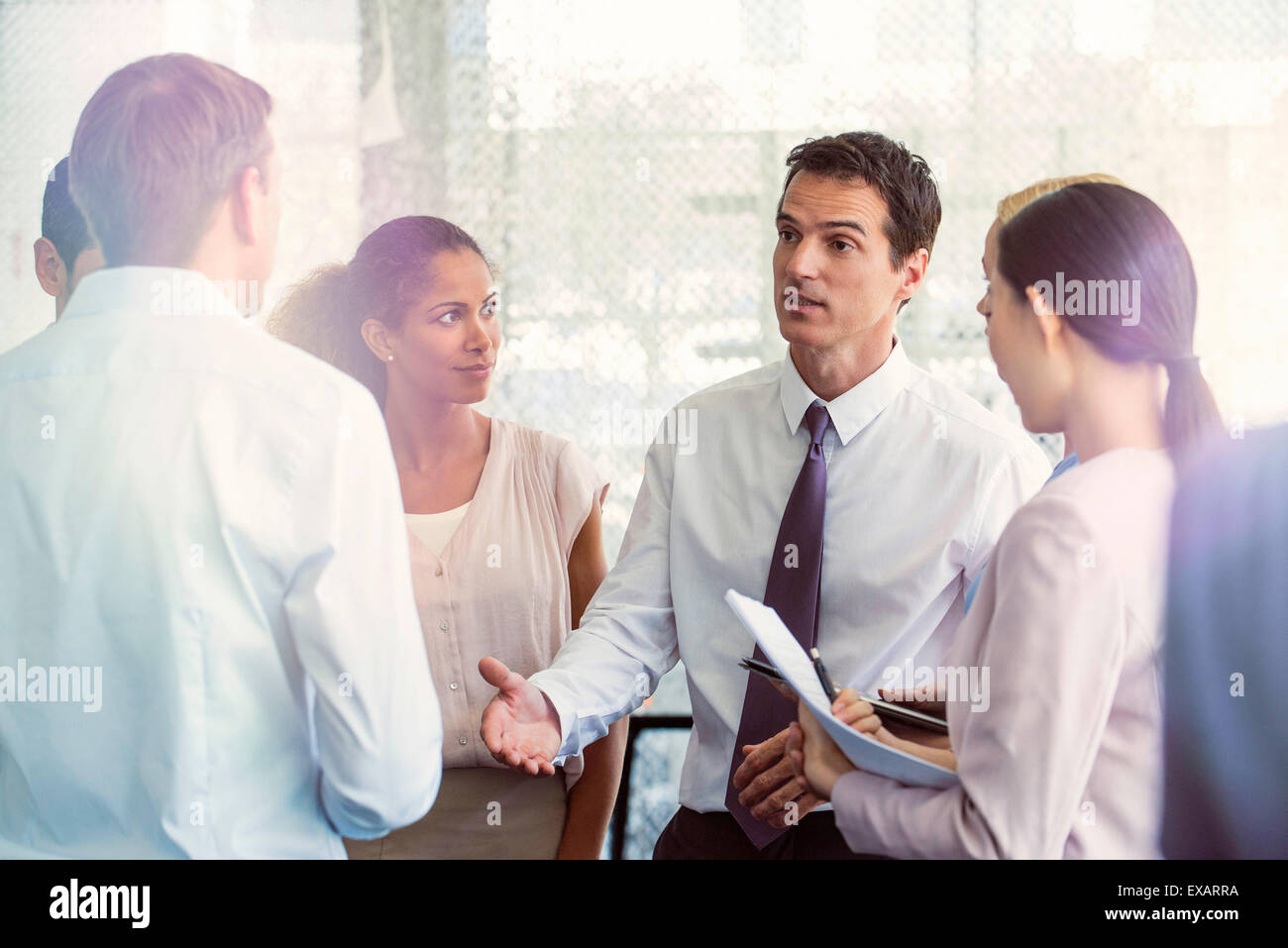 Team members receive direction from supervisor - Stock Image