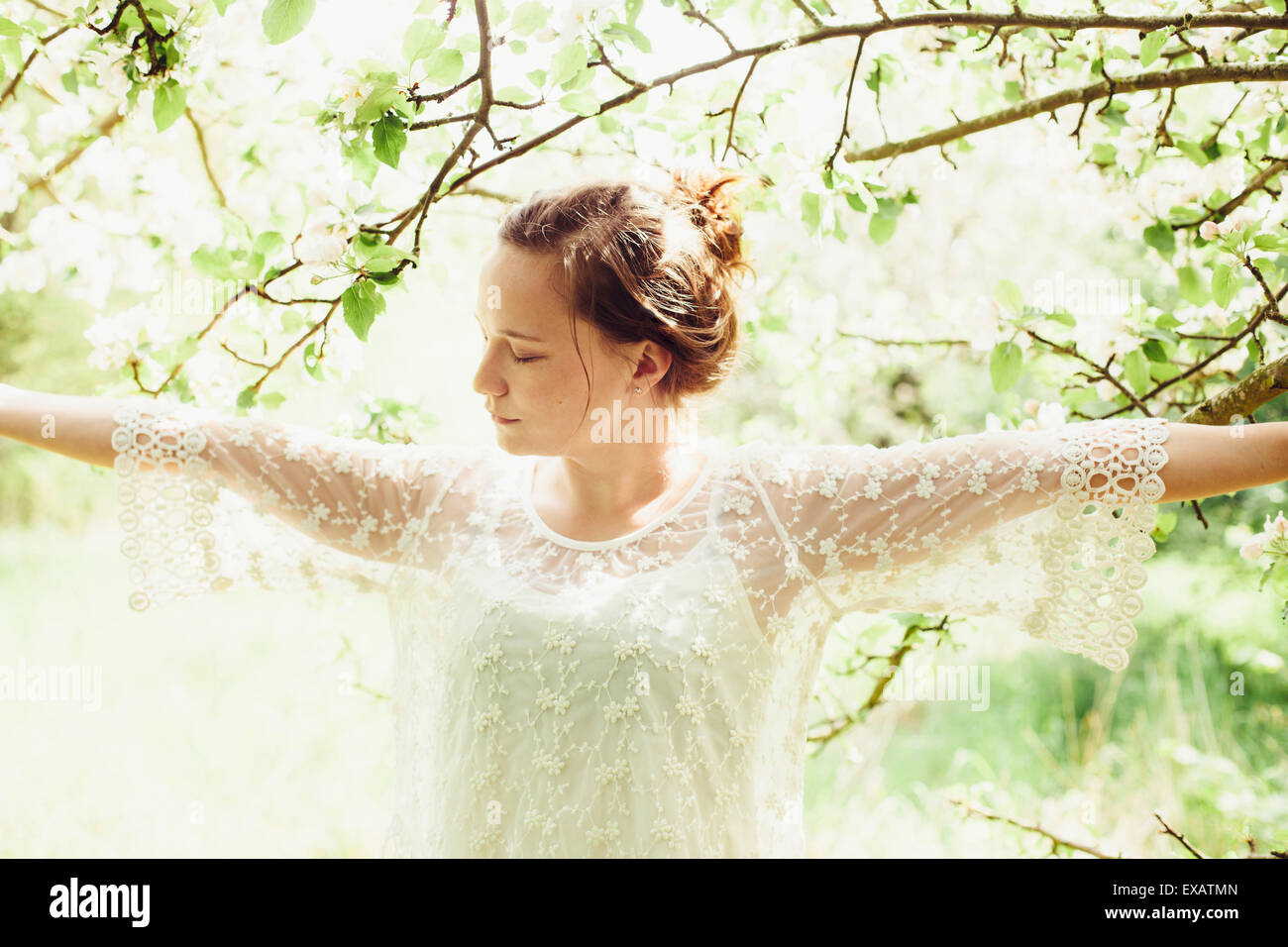 young woman happily in nature - Stock Image