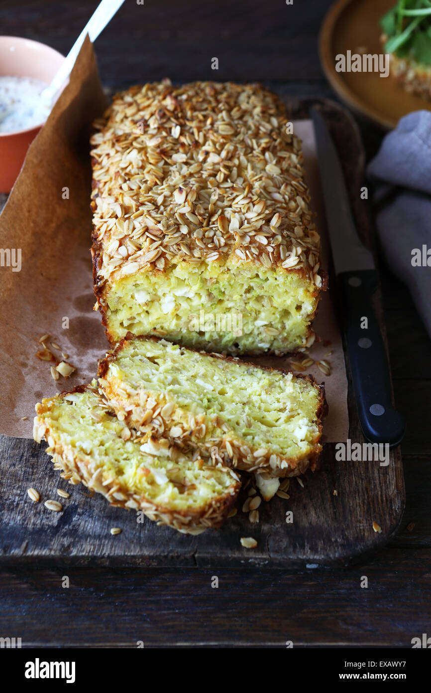 zucchini bread with cheese on cutting boards - Stock Image
