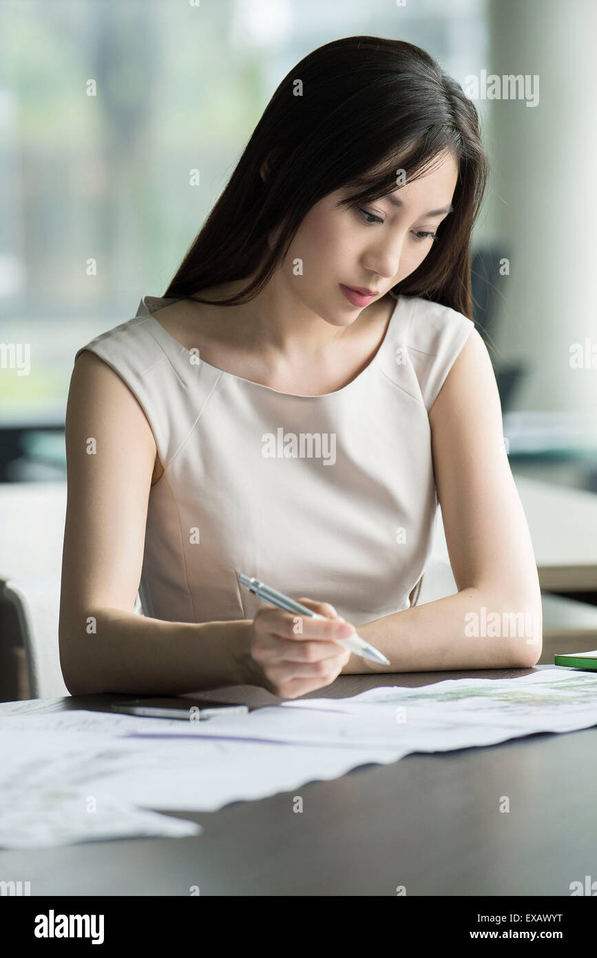 College student taking exam - Stock Image