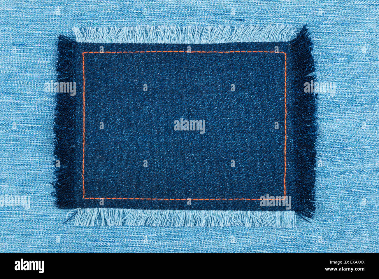Frame of  denim  with fringe with place for your text,on  jeans background - Stock Image