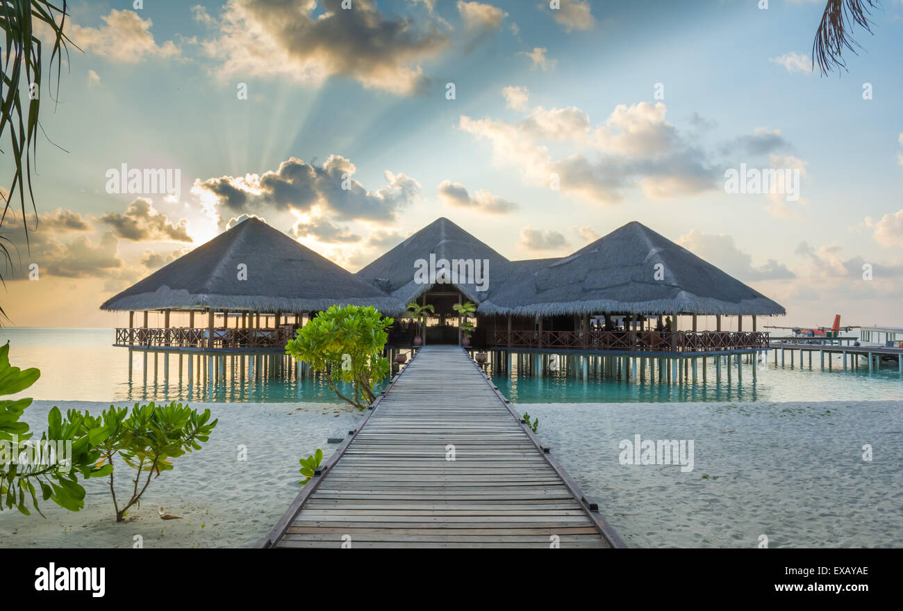 Jetty leading to overwater resort hotel restaurant and arrival - Stock Image