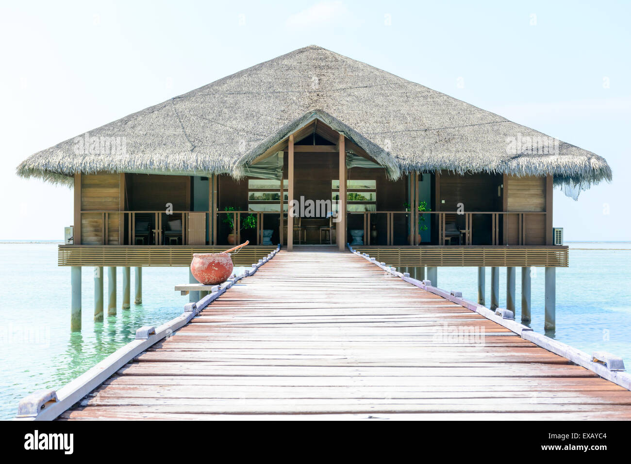 Overwater hut and jetty at a resort in Maldives - Stock Image