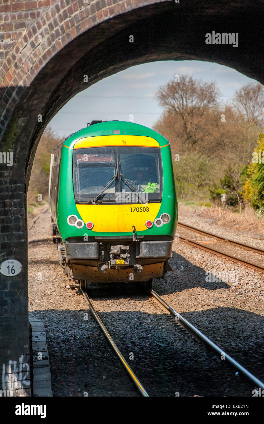 London Midland train travelling on a branch line in England. - Stock Image