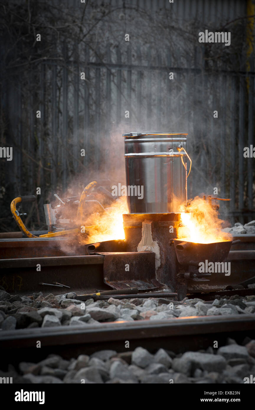 Thermit welding on a rail track in England. - Stock Image