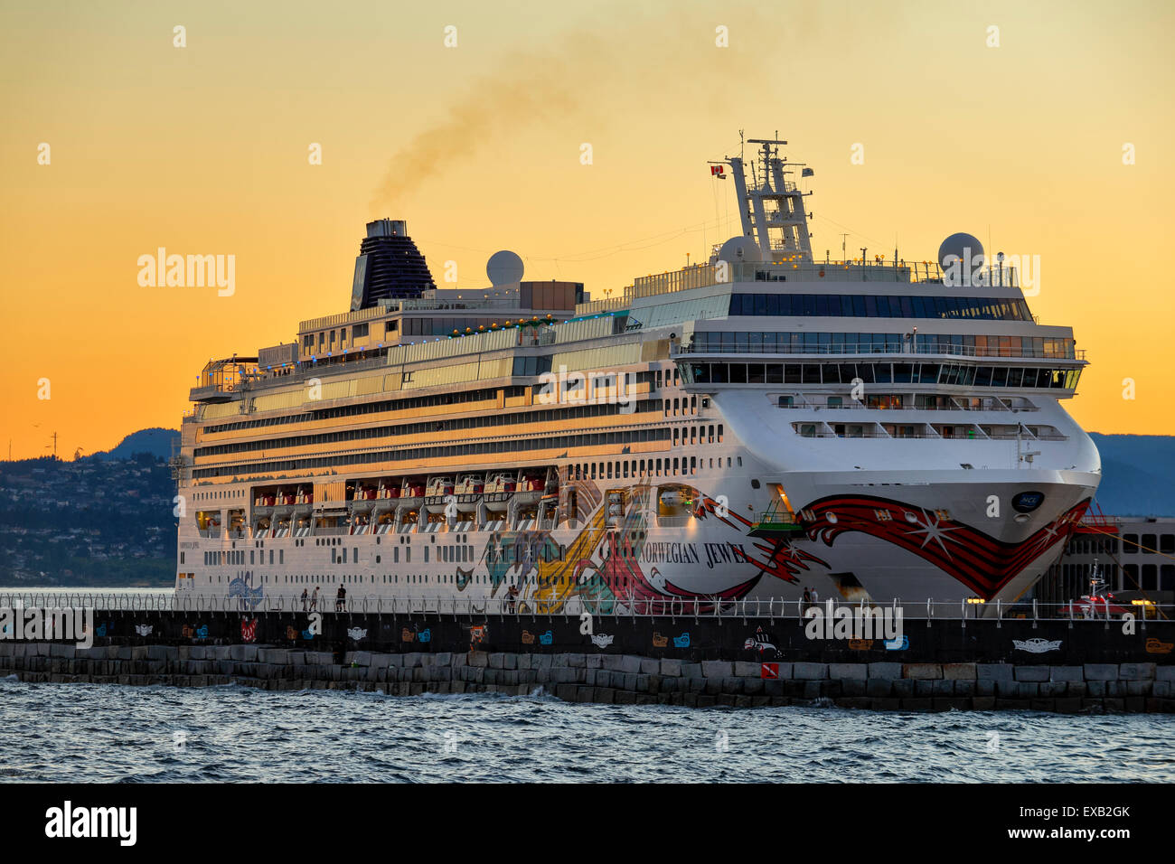 Cruise ship Norwegian Jewel docked at Ogden Point port at sunset-Victoria, British Columbia, Canada. - Stock Image
