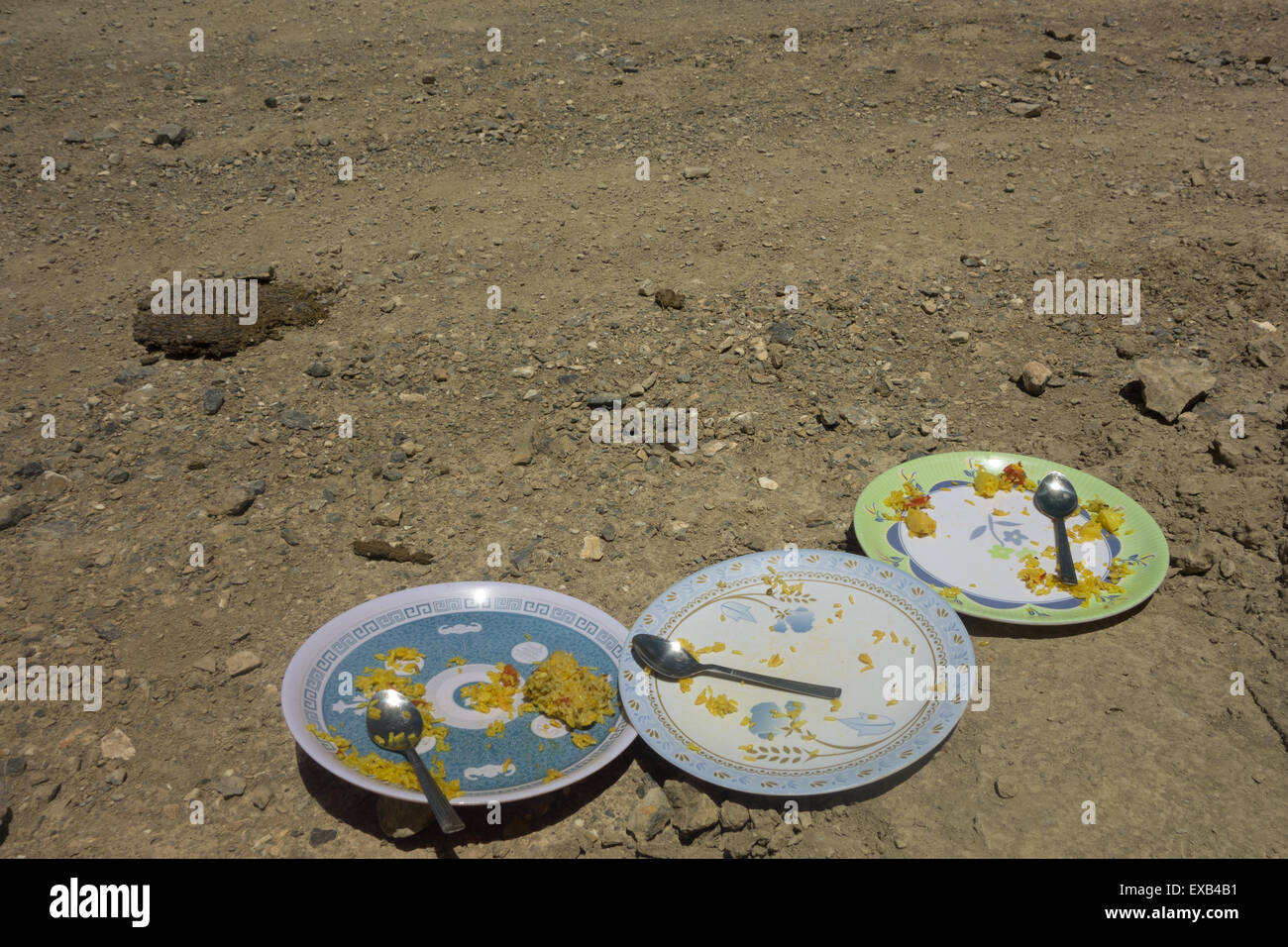 empty plates of vegetables and rice on trek in the Spiti Valley, Himachal Pradesh, India - food and guide provided - Stock Image