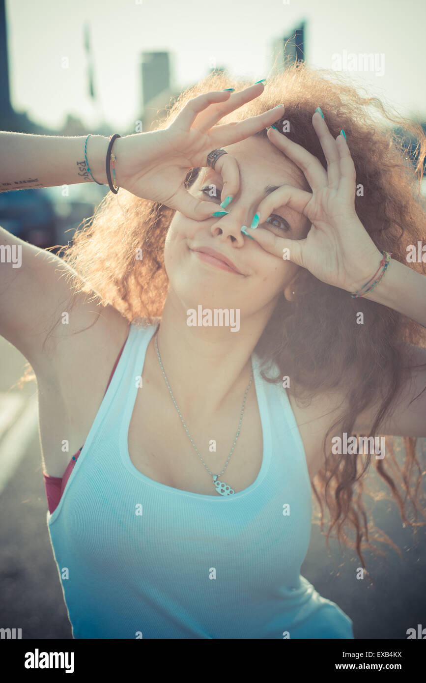 young beautiful long curly hair hipster woman in the city Stock Photo