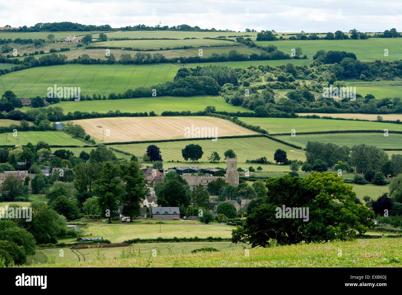 Landscape looking over Long Compton village, Warwickshire, England, UK - Stock Image