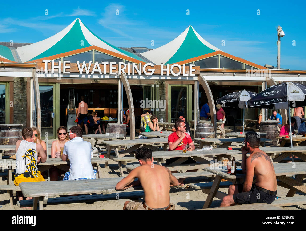 The Watering Hole bar on the beach at Perranporth, Cornwall, UK - Stock Image