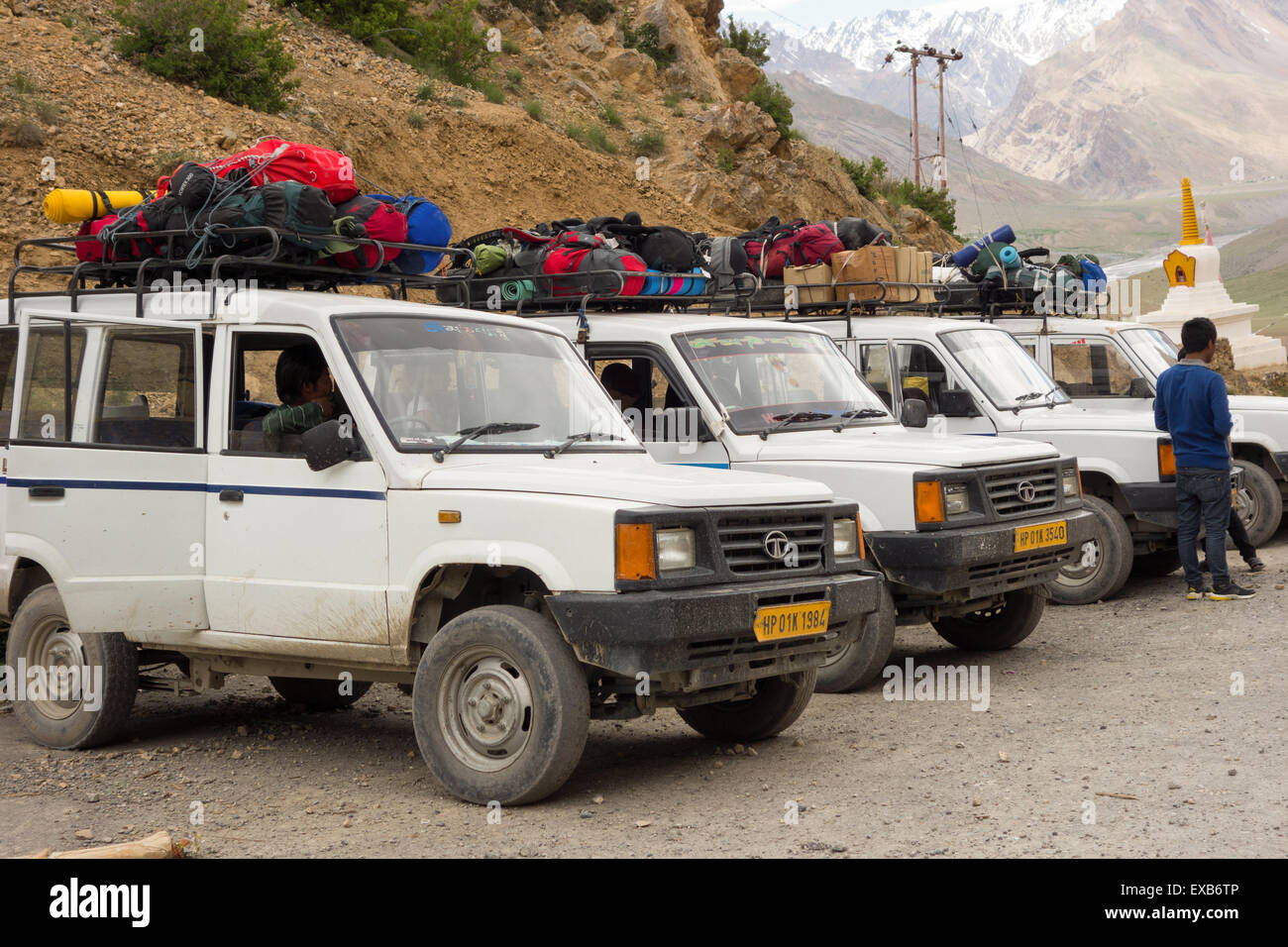 Spiti Vallley, Himachal Pradesh - line of Tata 4x4 vehicles loaded with eco tourist luggage and camping equipment - Stock Image
