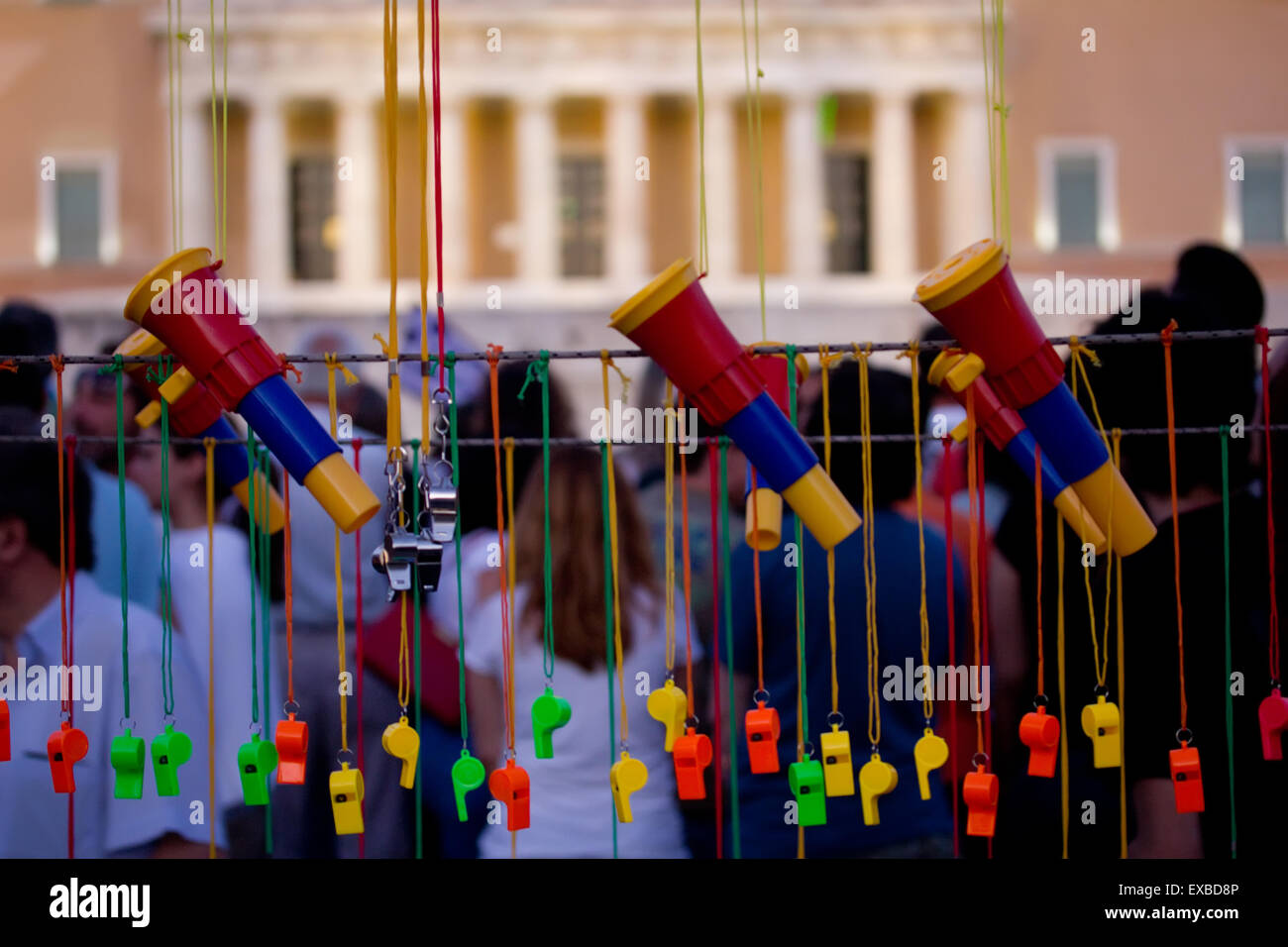 Protesters sound arsenal, hanging whistles, vuvuzelas opposite Greek parliament, at the antiausterity measure protests - Stock Image
