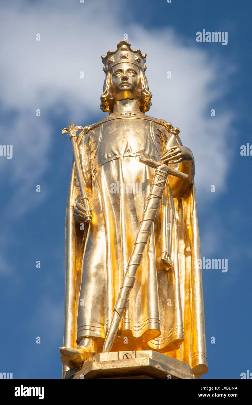 A statue of King William II at the fountain in Parliament Buildings in The Hague against a blue sky with clouds. Stock Photo