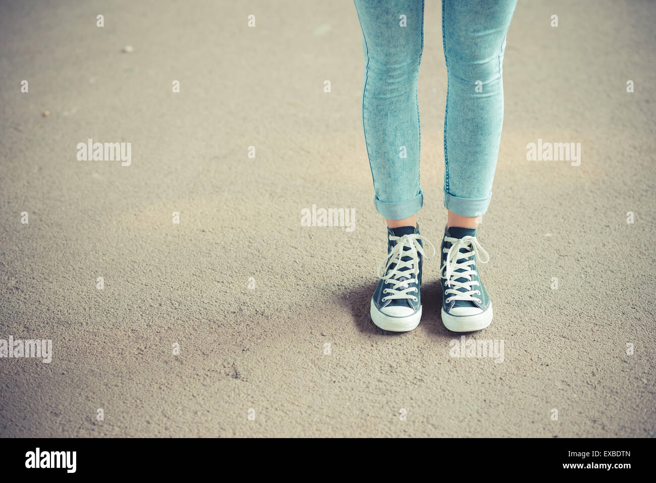 close up of legs woman with leggings and sneakers outdoor - Stock Image