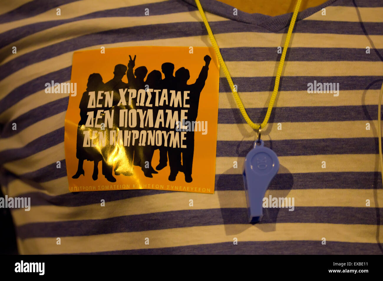 Mass sticker slogan on Tshirt stating 'We do not owe, We do not sell, We do not pay' at the Greek antiausterity - Stock Image