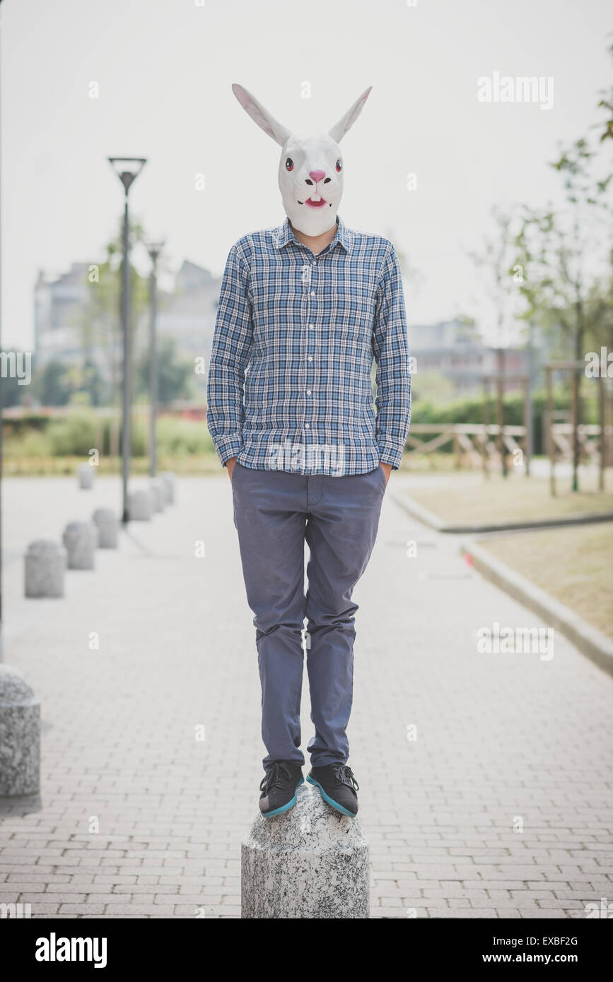 rabbit mask absurd man in the city - Stock Image