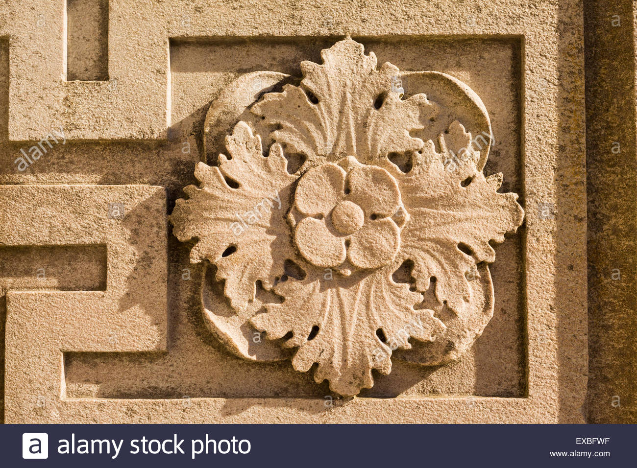 Rosette on a meander or Greek key design saved from demolished buildings relocated to The Guild park, in Toronto - Stock Image