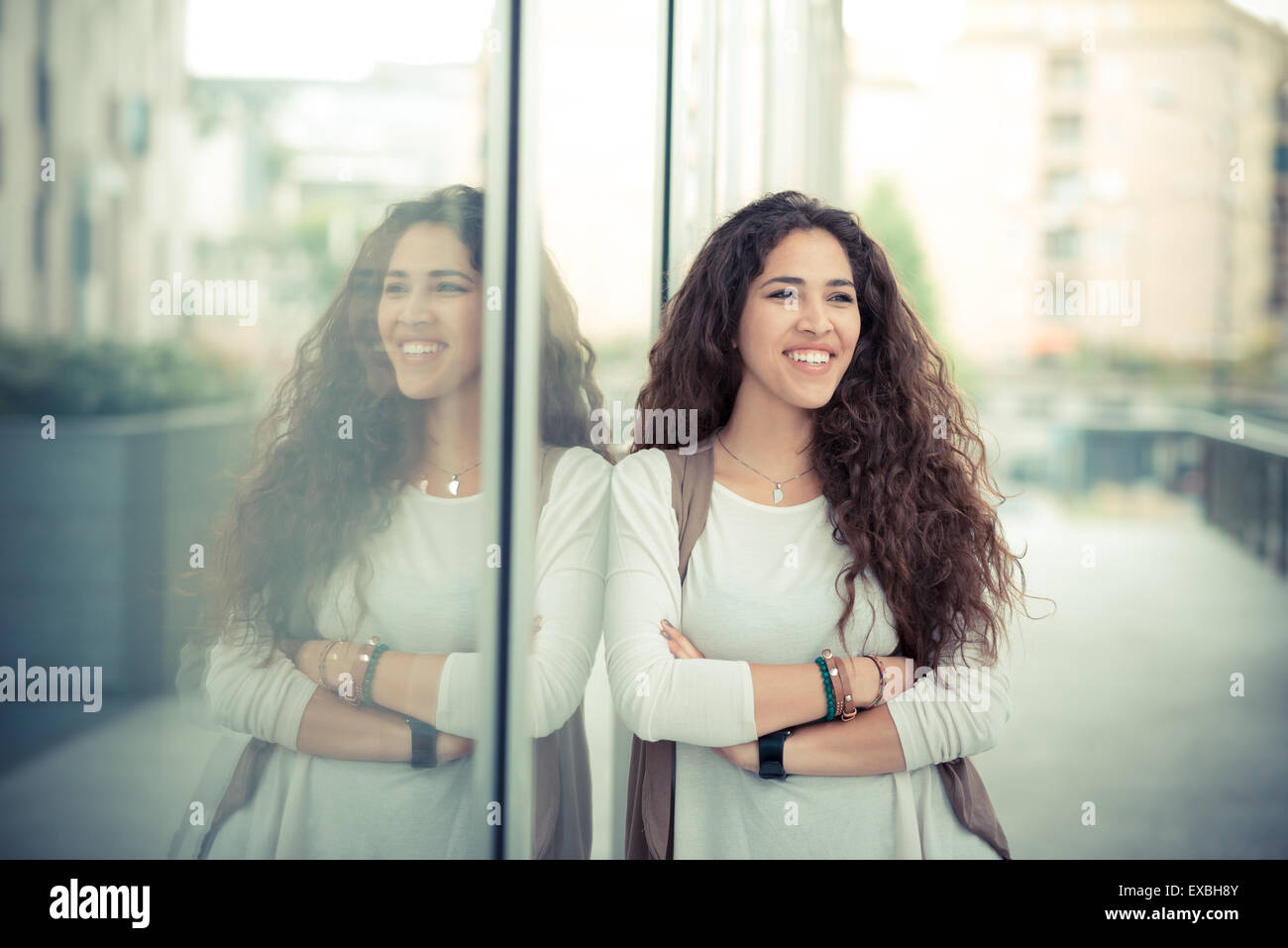beautiful curly long brunette hair moroccan woman in the city Stock Photo