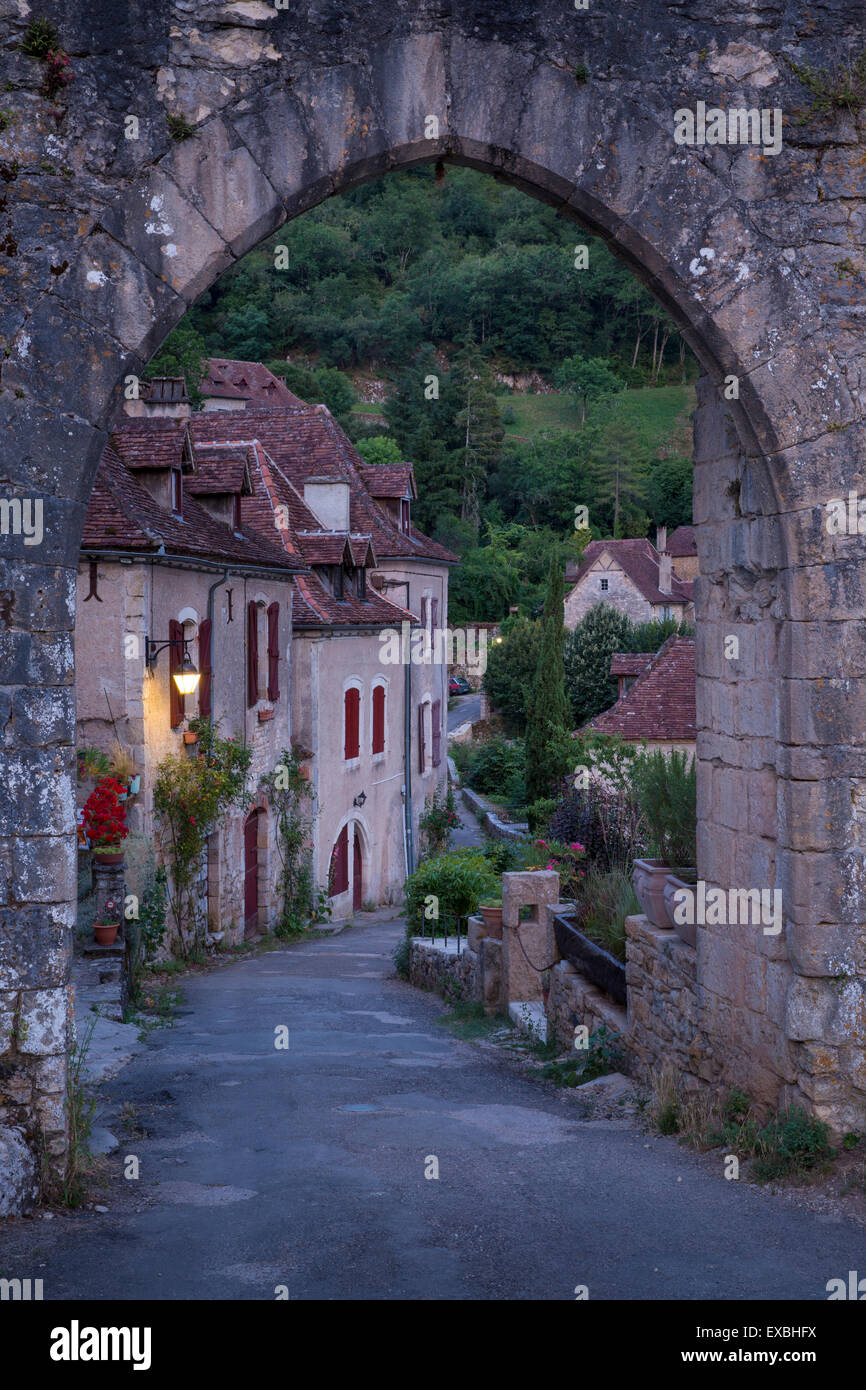 Pre-dawn at the old entry gate to medieval town of Saint-Cirq-Lapopie, Midi-Pyrenees, France - Stock Image