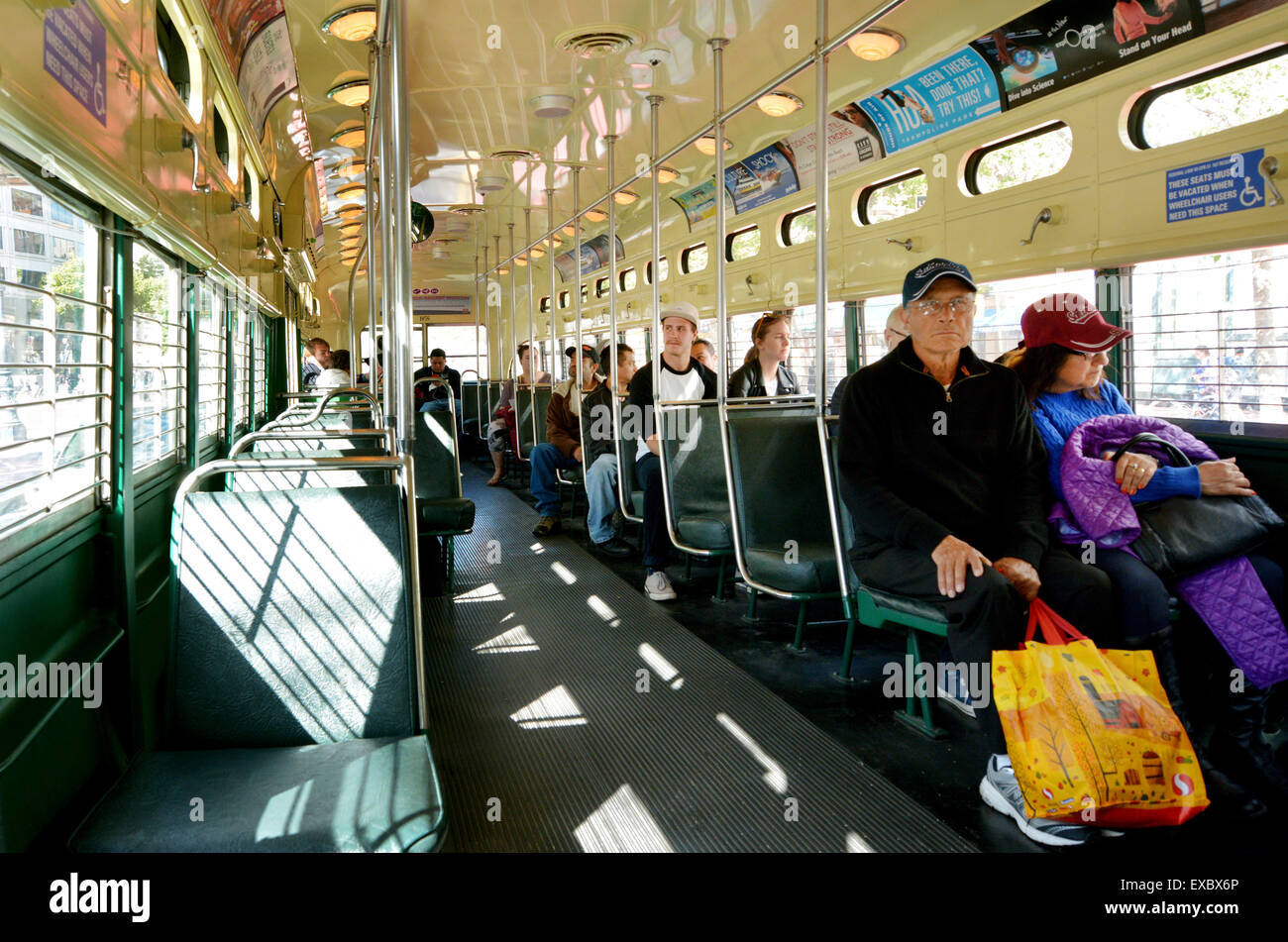 SAN FRANCISCO - MAY 15 2015:Passengers ride on San Francisco's original double-ended PCC streetcars.In ridership - Stock Image