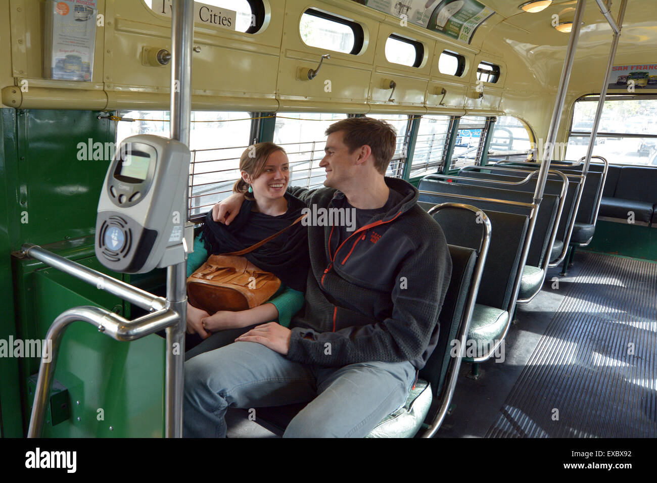 SAN FRANCISCO - MAY 15 2015:Happy American couple ride on San Francisco's original double-ended PCC streetcars. - Stock Image