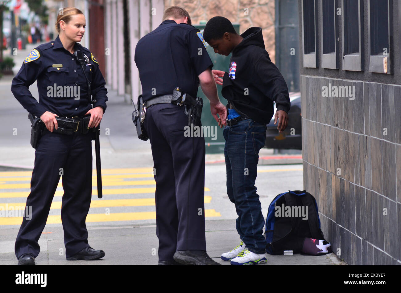 SAN FRANCISCO - MAY 15 2015:SFPD officers patdown black american man in San Francisco.Overall, Black Americans are - Stock Image