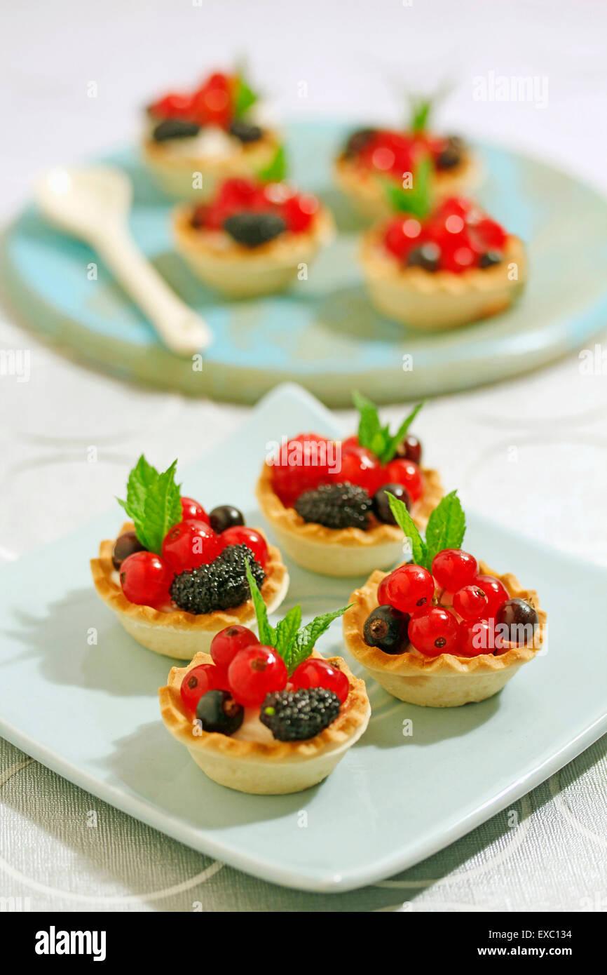 Wild berries tartlets. - Stock Image