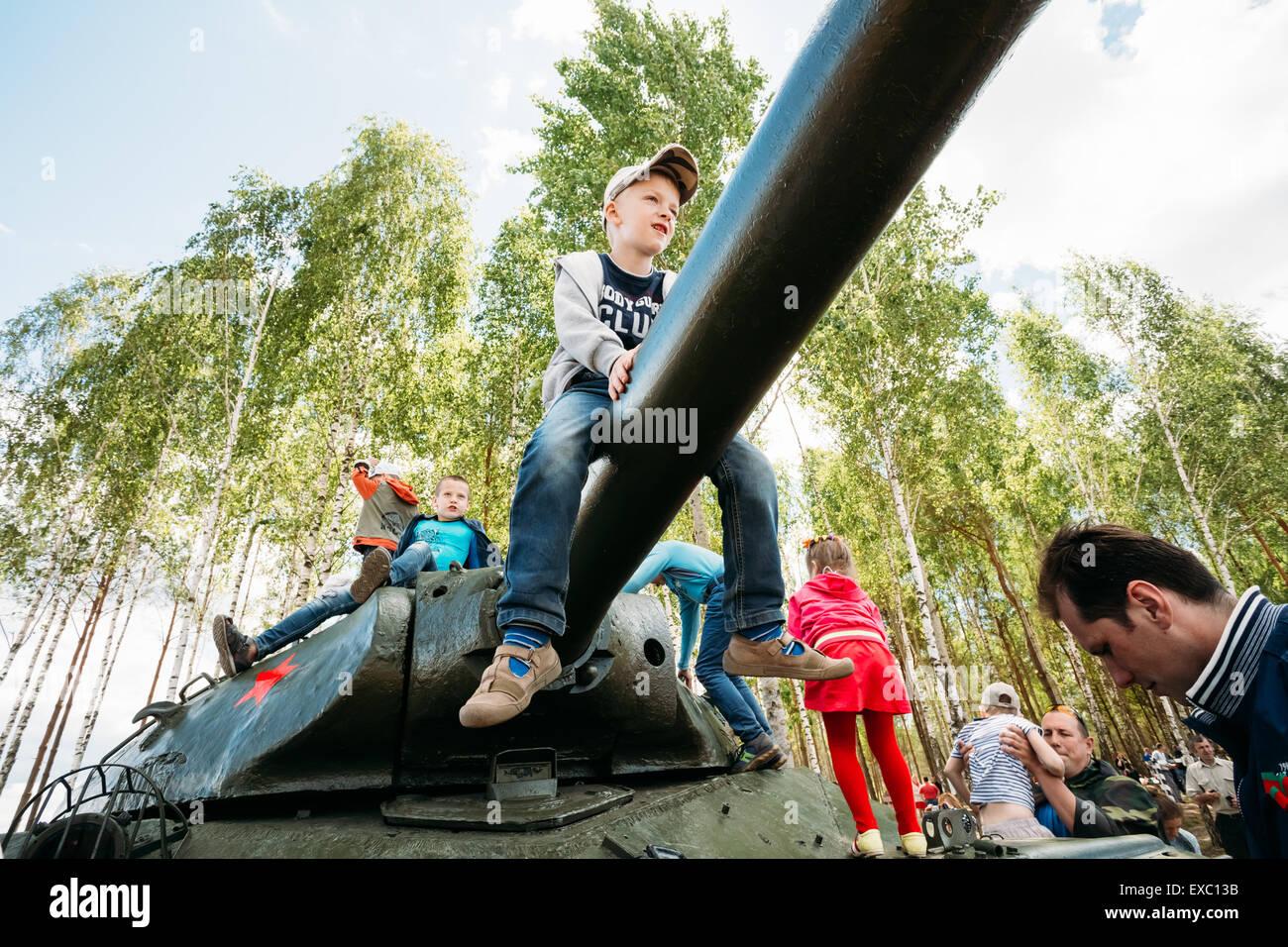 SVIETLAHORSK, BELARUS - JUNE 21, 2014: Children climb on Soviet tank from World War II during celebration events Stock Photo