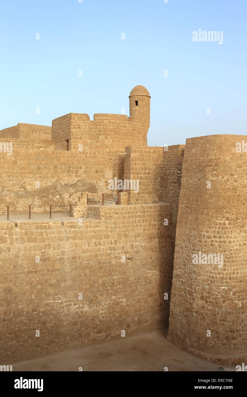 Fortified walls, turret and moat of the Bahrain Fort, Kingdom of Bahrain - Stock Image