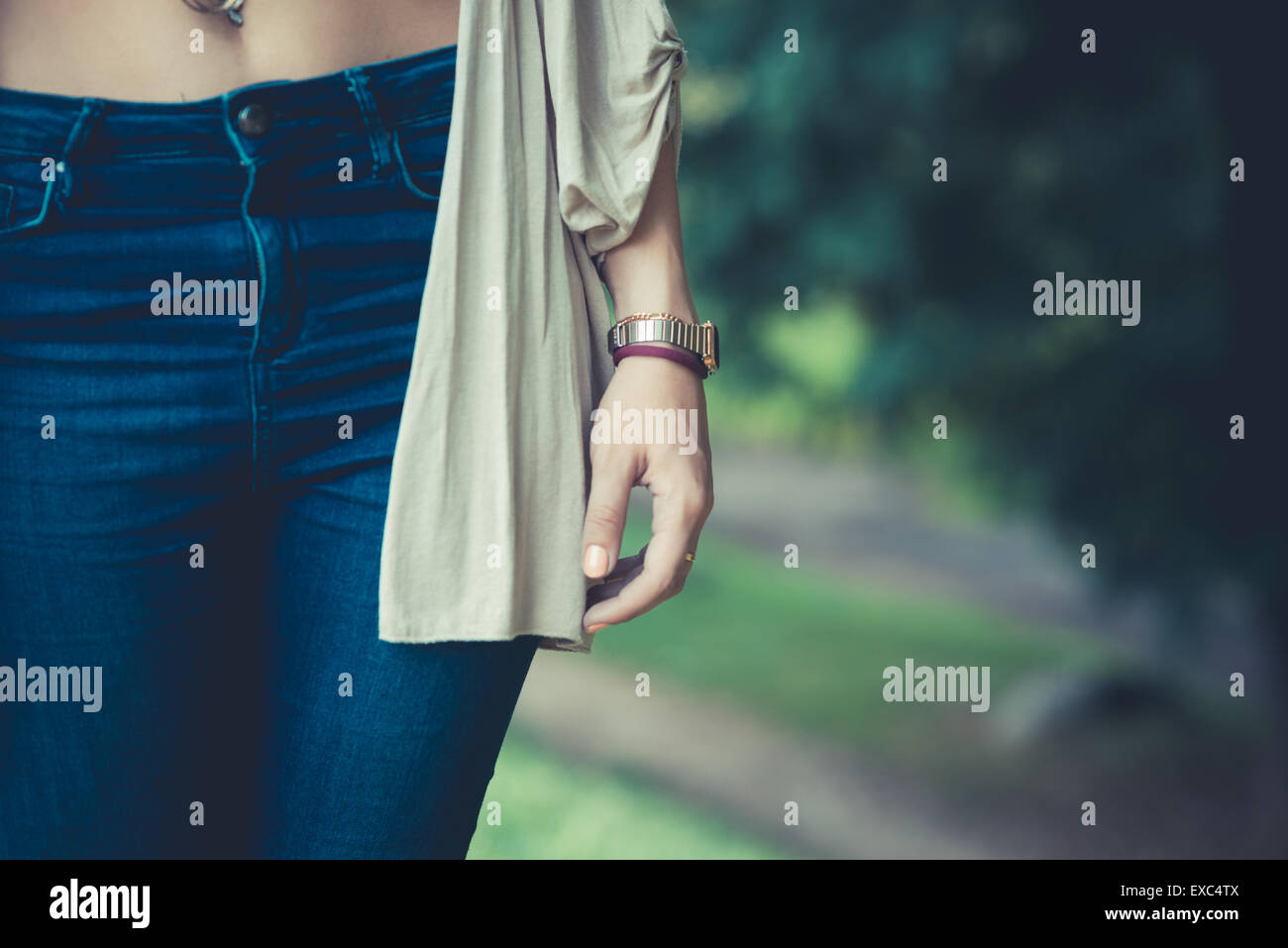 close up of belly button of young woman outdoor - Stock Image