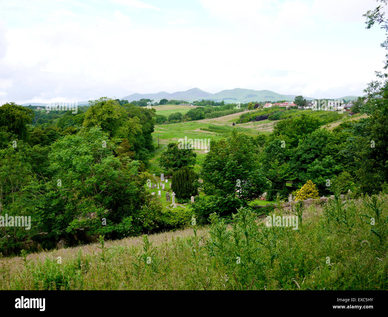 A view towards the Pentland Hills from Rosslyn Chapel, Roslin, Midlothian, Scotland, UK. - Stock Image