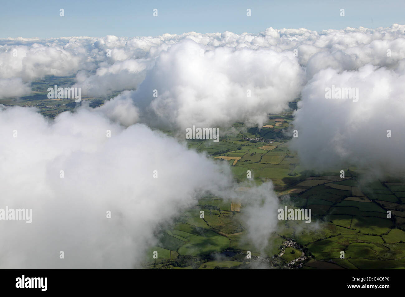 aerial view of fluffy clouds in sky as seen whilst flying at 2000', UK - Stock Image