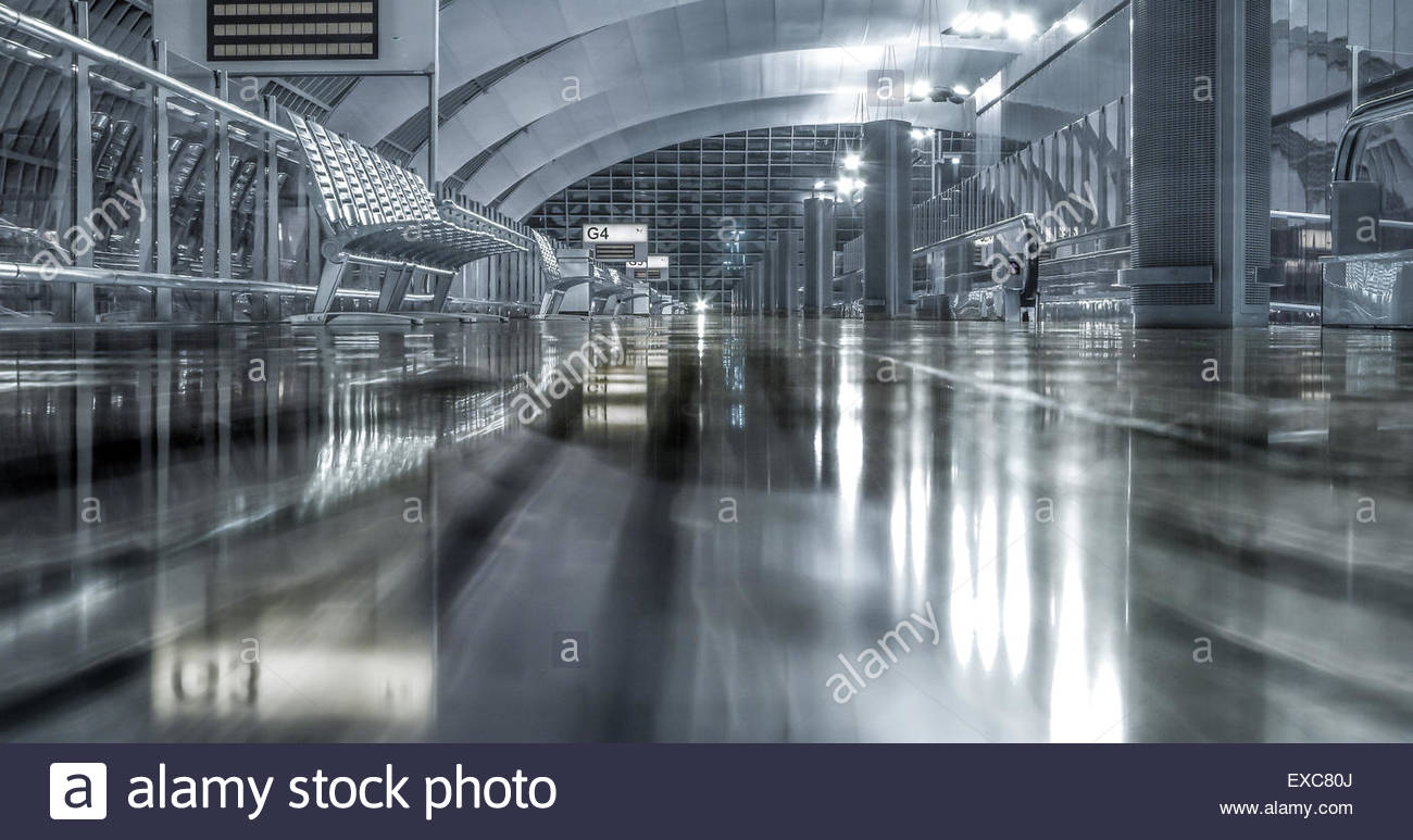 Airport terminal at night between flights. - Stock Image