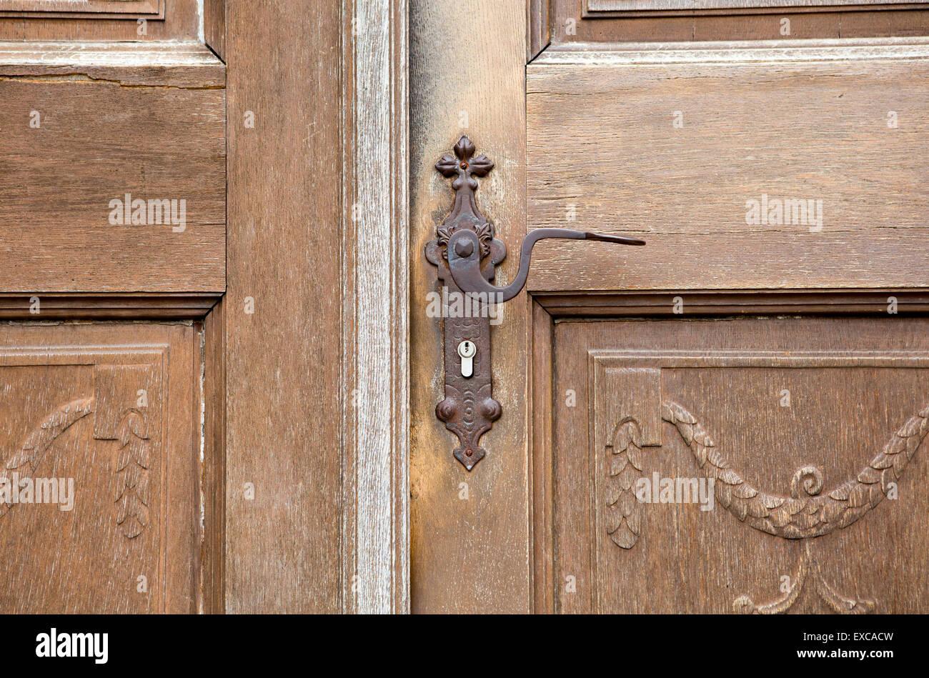 Old Wooden Entrance Door With Antique Door Handle And Modern Lock