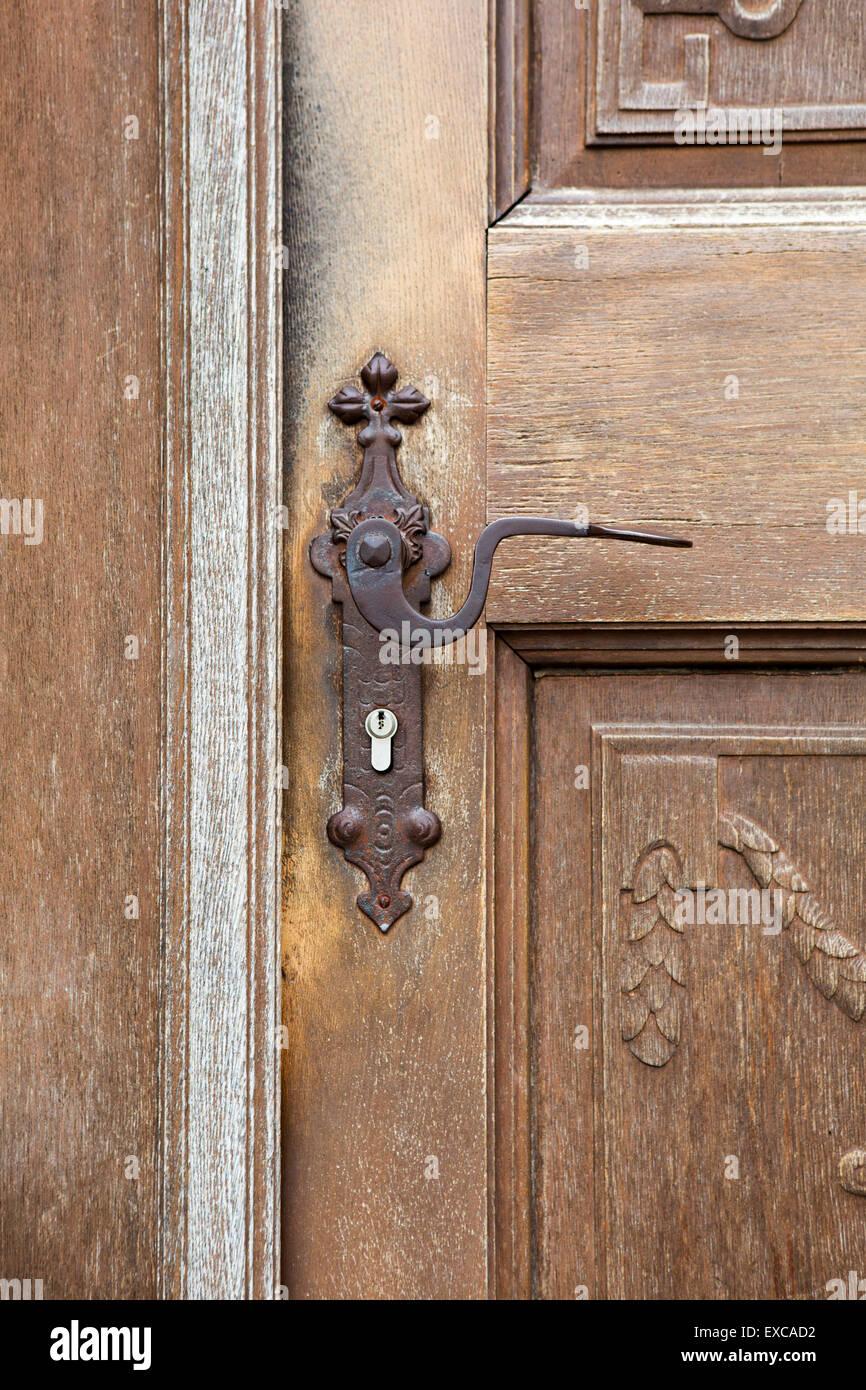 old wooden entrance door with antique door handle and modern lock - Old Wooden Entrance Door With Antique Door Handle And Modern Lock