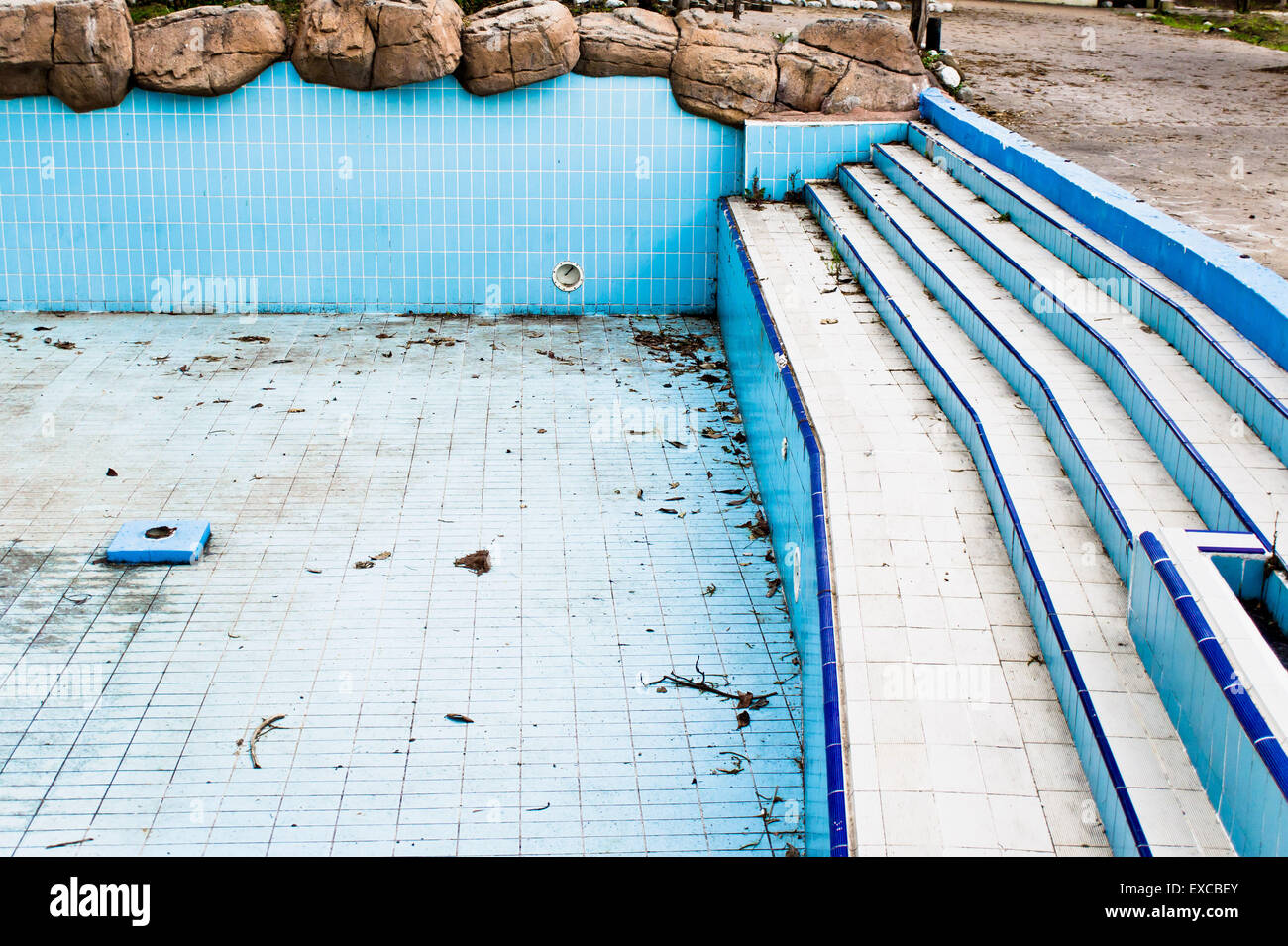 A derelict swimming pool in an abandoned amusement park - Stock Image