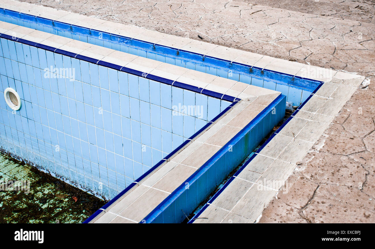 Corner of a derelict swimming pool in Turkey - Stock Image