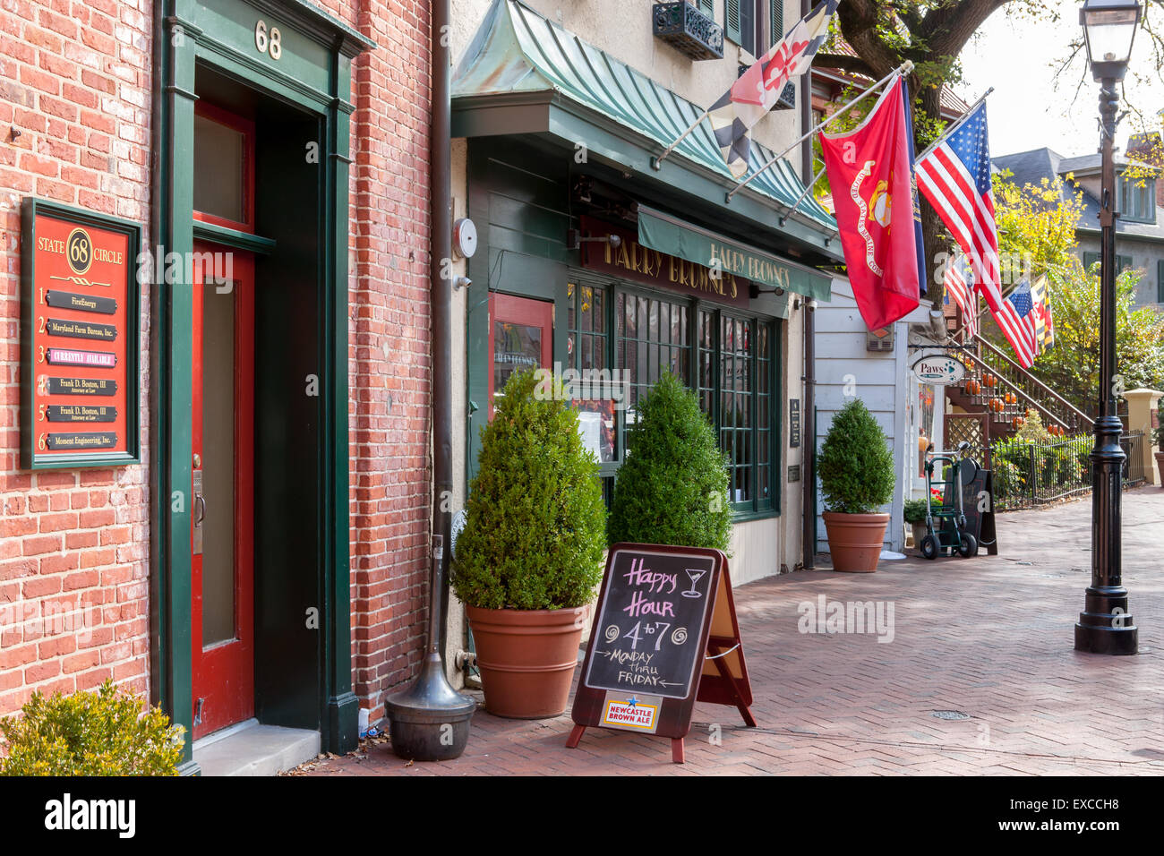 Facades with flags on State Circle in Annapolis, Maryland. - Stock Image