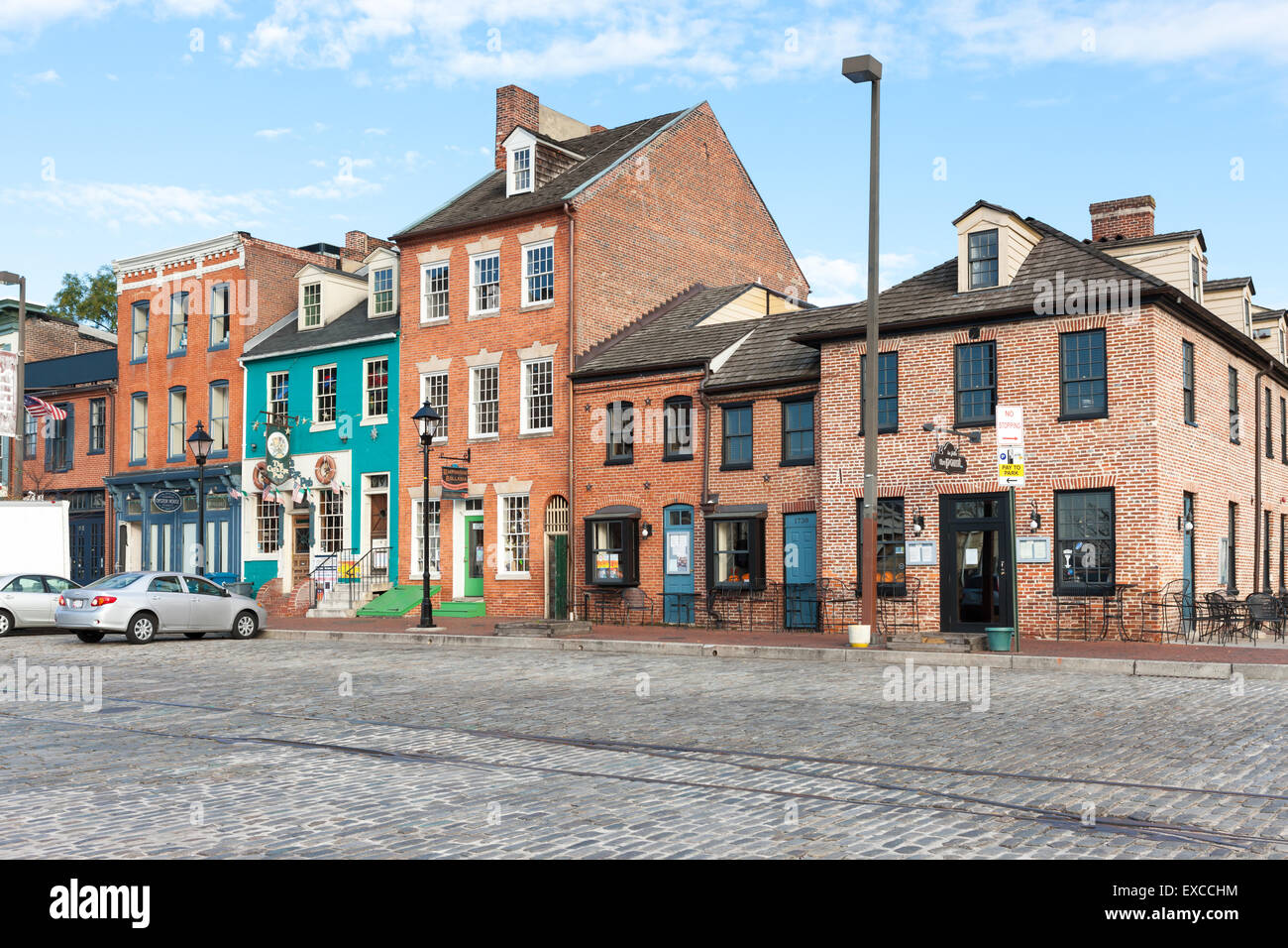 Mixed-use buildings on Thames Street in the historic Fell's Point neighborhood in Baltimore, Maryland. - Stock Image