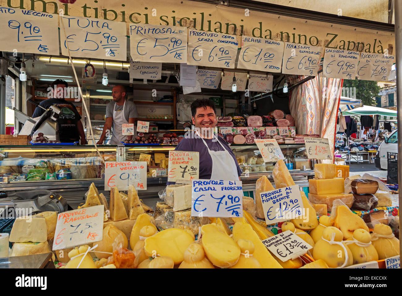 Cheese seller at Catania street market, Catania town, Sicily, Italy Stock Photo