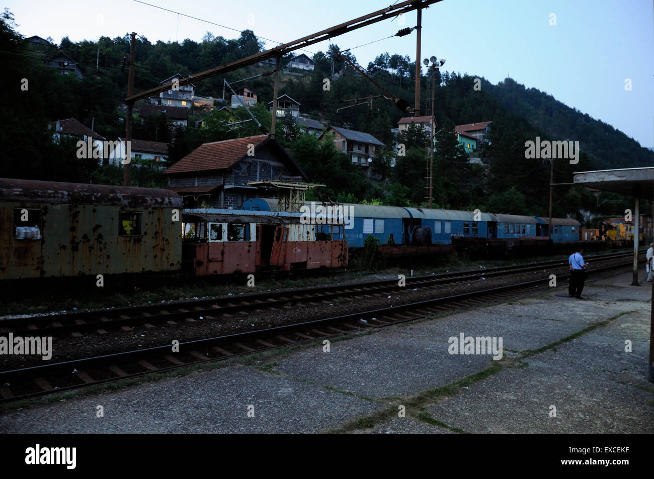 Damaged train on the railway station in small town in Bosnia. - Stock Image