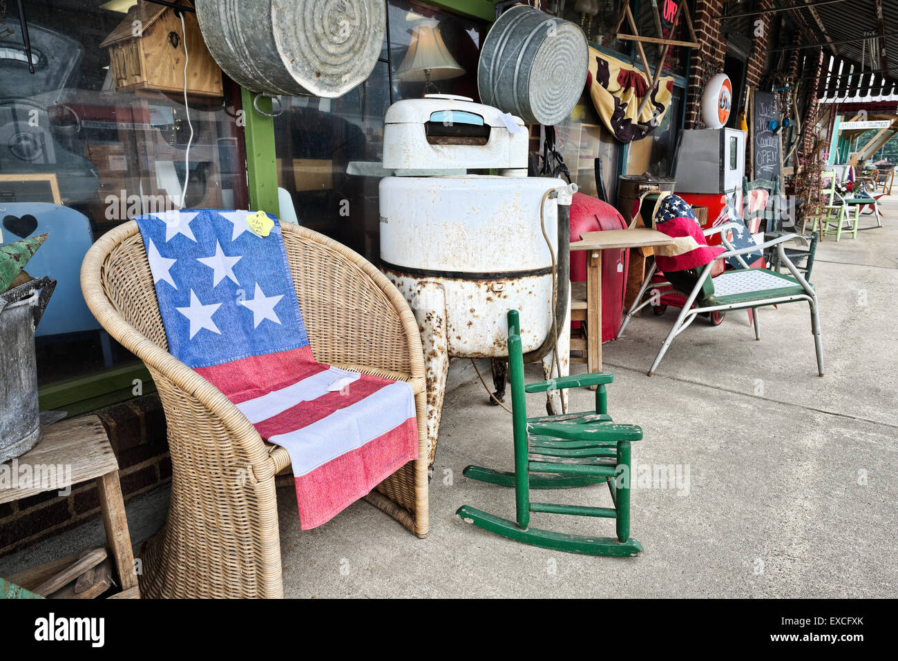 Sidewalk antiques outside antique store Just Plain Country in Walnut Cove, North Carolina - Stock Image