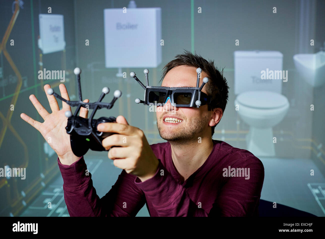 Augmented reality male man playing with glasses and handset - Stock Image