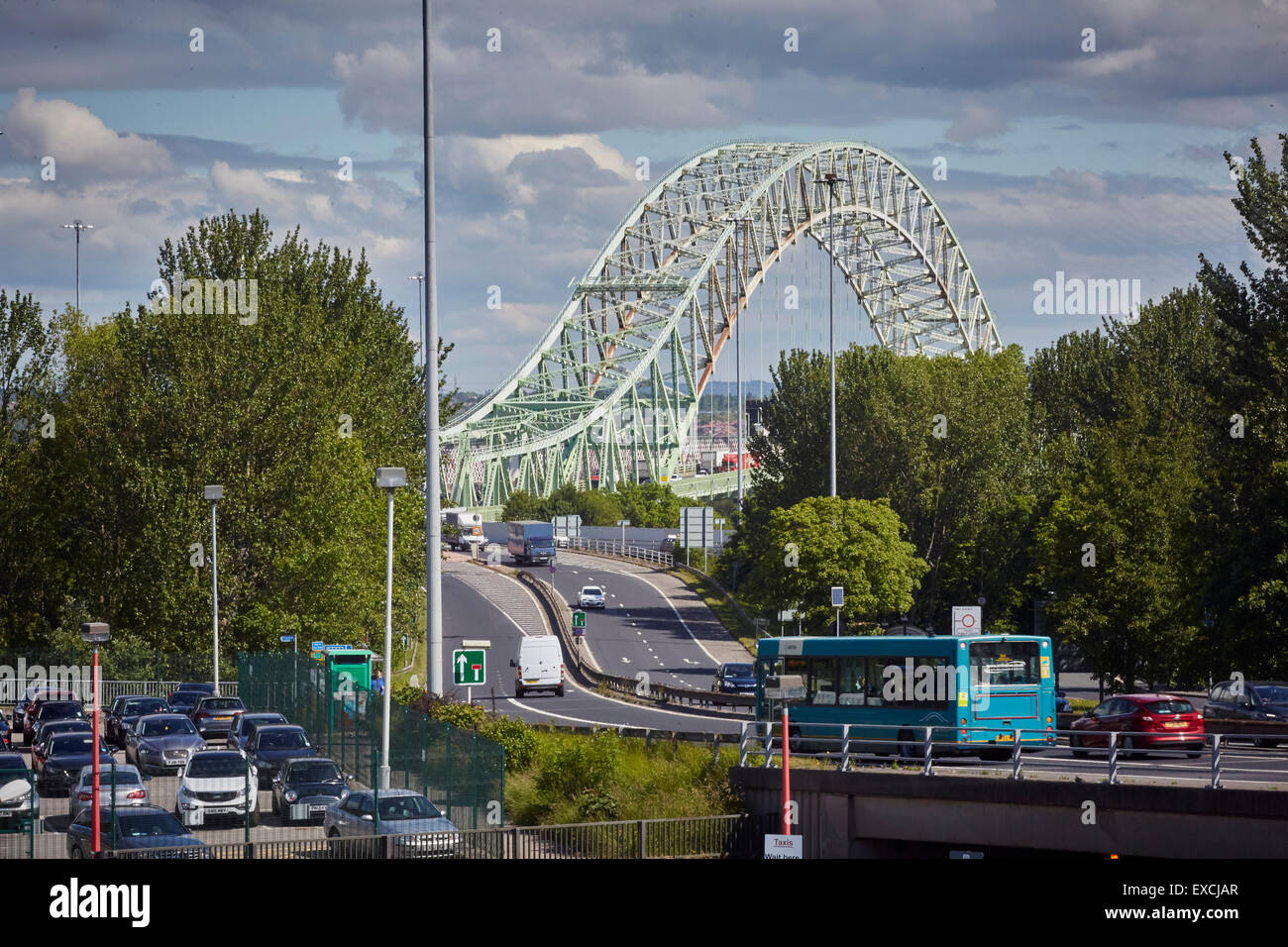 Runcorn is an industrial town and cargo port in Halton, Cheshire, UK.  Pictured The Silver Jubilee Bridge or Runcorn - Stock Image