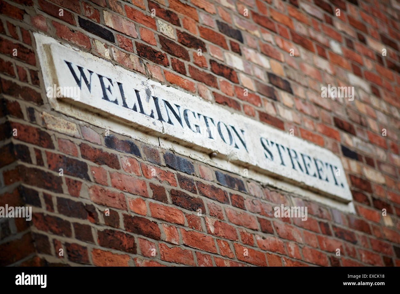 A stone street sign for Wellington Street, Runcorn - Stock Image