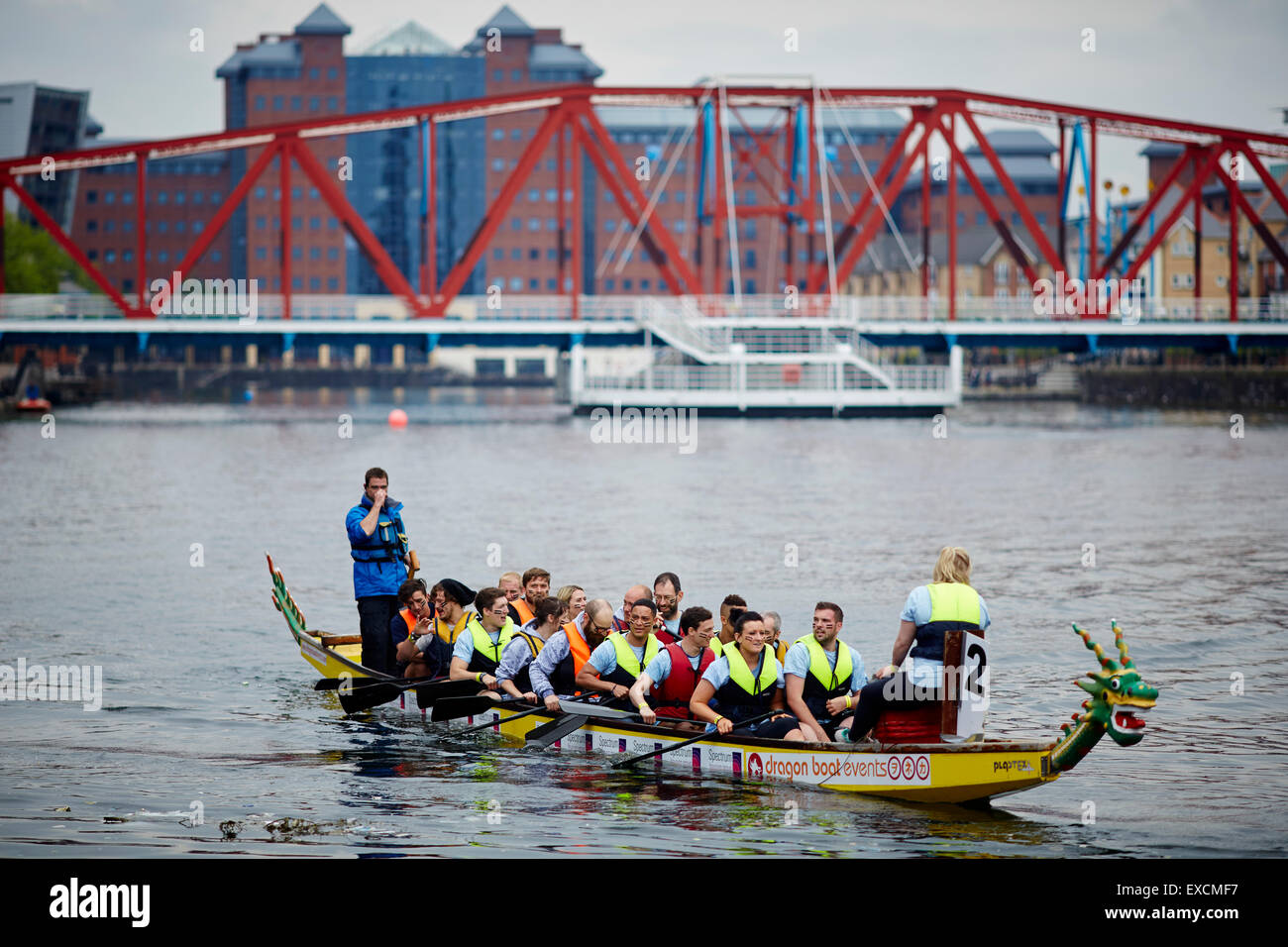 Salford Quays with the Detroit Bridge a dragon boat race in the basin UK  Great Britain